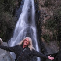 Martha Halda, taking in a Himalayan waterfall