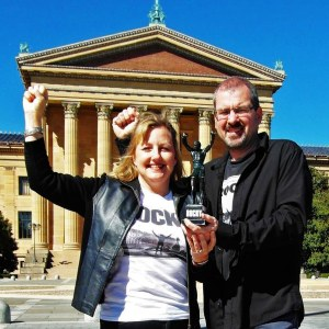 Larissa and Michael Milne pose with their Rocky statue in Philadelphia. The statue made the journey with them.