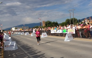 Martha pushes for home in front of large crowds on the Clark River Bridge